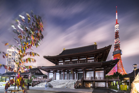 Japanese lanterns made of hand-made washi rice paper arranged in the shape of a milky way illuminating the stones of the steps of the Zojoji temple near the Tokyo Tower during the night of Tanabata. Language of the keywords: English