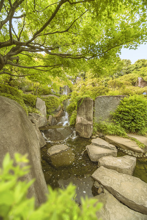Waterfall of the Meijiro garden that flows into the central pond 스톡 콘텐츠