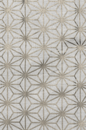 Highly detailed all over background texture of traditional japanese silver and white hemp leaf shaped pattern design textile in synthetic fabric. Banco de Imagens