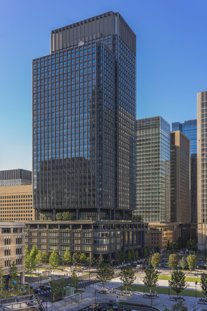 The Shin Marunouchi Building at Marunouchi side of Tokyo railway station in Chiyoda City, Tokyo, Japan. This commercial complex building often called