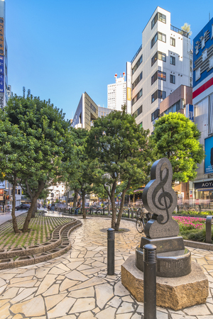 TOKYO, JAPAN - August 21 2018: Marble monument shaped in treble clef on Sunshine Street at the exit of Ikebukuro in Tokyo.The sidewalk