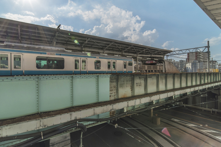 Oji Railway Station overlooking the Oji Crossing Intersection in the Kita district of Tokyo in Japan.