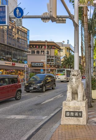 American Village, Japan - September 17, 2018: kokusai dori street which means international street decorated with two shisa lion sculptures in the city of Naha in Okinawa Editöryel