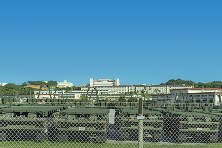 Motorized vehicles lined up at a US military base on the island of Okinawa Stok Fotoğraf - 127813293
