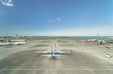 Okinawa, Japan - September 14, 2018: Boeing plane on the tarmac of the Okinawan airport of Naha Airport with a beautiful blue sky summer