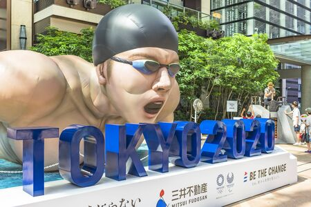 TOKYO, JAPAN - July 26,2019: Event Be the change Tokyo 2020 organized on the theme of the future Olympic Games in Tokyo in 2020. In the Coredo Muromachi Terrace of Tokyo stood a huge inflatable structure in the shape of a swimming athlete in action. Aro Redactioneel