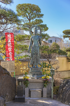 Tabata, Japan - January 03 2019: Bronze statue of Togakuji temple in Tokyo depicting Japanese bodhisattva Habataki Kannon Bosatsu which means