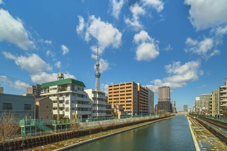 The Yokojukken River also named the Tenjin River because of its proximity to the Kameido Tenjin Shrine in Tokyo's Kuroda district with the Skytree Tower in the background.