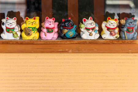 tokyo, japan - march 31 2020: Manekineko lucky cats depicting the seven gods of happiness Bishamonten, Ebisu, Daikokuten, Hotei, Jurojin, Benzaiten and Fukurokuju in the shopping street Yanaka Ginza. Editorial