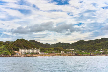 Coast of the Kanaya Marina along the Uraga Channel with the loop ramp of the Futtsu Kanaya Interchange in front of the Mount Nokogiri in the B�s� Peninsula.