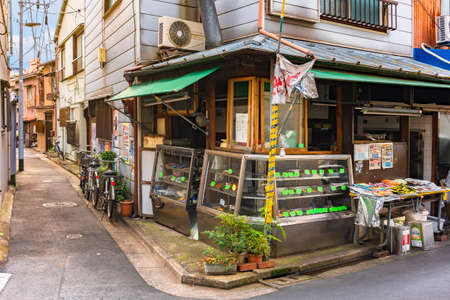 tokyo, japan - march 12 2021: Retro delicatessen store selling variety of homemade fried tempura vegetables and fishes with croquettes of potatoes and meat at a neighborhood street corner of Sumida. Sajtókép
