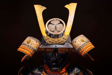 tokyo, japan - april 07 2020: Japanese Kabuto helmet adorned with the coat of arms of Tokugawa Shoguns named Mitsuba-aoi or hollyhock leaves exhibited at the entrance of the Samurai Museum in Shinjuku