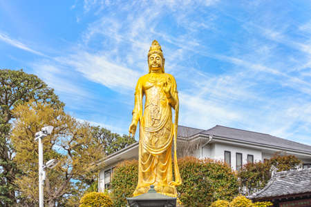 tokyo, japan - march 15 2021: Golden Buddhist statue of Kishou Kanzeon bodhisattva or kanon bosatsu known as protector of the Edo castle in the zenshoan zen temple of Yanaka created by Yamaoka Tesshu.
