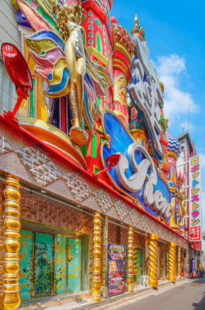 tokyo, japan - march 15 2021: Facade of the famous American Bar & Café Ren adjacent to the sightseeing Robot Restaurant which design is inspired by the catchy and kitsch style of casinos in Macau.