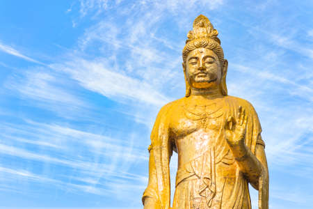tokyo, japan - march 15 2021: Close up on the bust of the golden Buddhist statue of Kishou Kanzeon bodhisattva or kanon bosatsu in the zenshoan zen temple of Yanaka created by Yamaoka Tesshu. Sajtókép