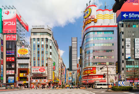 tokyo, japan - april 07 2019: Pedestrian crossing of the Central Road of Kabukicho famous for its Godzilla Road arch and the department store of Don Quijote in the red-light district of Shinjuku.