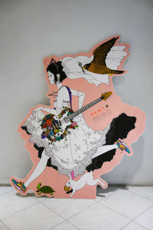 tokyo, japan - may 14 2018: Life sized standee depicting an illustration of a Japanese girl in wedding dress during the exhibition all around Yusuke Nakamura at Parco department store of Ikebukuro.