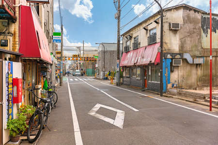 tokyo, japan - october 11 2020: Dilapidated facades of local shopping district of Kanegafuchi street leading to the level crossing of the Kanegafuchi station in the Sumida ward of Tokyo.