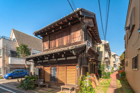 tokyo, japan - march 31 2021: Wooden house of an old Japanese Sake factory rehabilitated into retro Exhibition space Kourinsha in the ancient Hatsunecho district of Meiji era close to Yanaka cemetery.