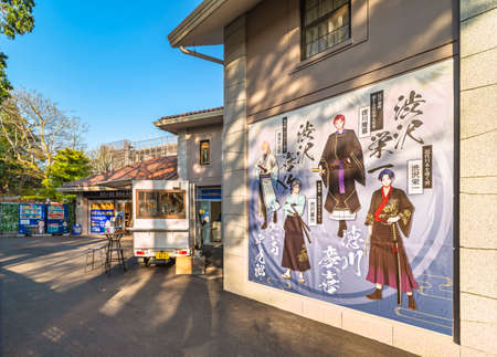 tokyo, japan - march 23 2021: Photo spot with Japanese historical characters in manga style and a kitchen car in front of the souvenir hall of the exhibition about Shibusawa Eiichi in Asukayama park.