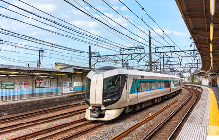tokyo, japan - november 13 2019: Futuristic Tobu 500 series limited express train branded Revaty contraction of words variety and liberty passing on the railways of Kanegafuchi station in Sumida city.