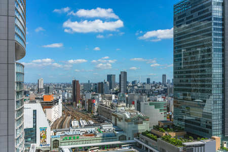 tokyo, japan - july 05 2021: Bird's-eye view of the South gate of the Japan Railway Shinjuku train station overlooked by the glassed facade of the JR Shinjuku Miraina Tower. Editöryel