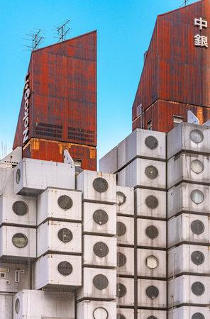 tokyo, japan - july 05 2021: Closeup on the rusted corrugated sheet rooftop of the famous Nakagin Capsule Tower building created in 1972 by Japanese architect Kisho Kurokawa in Shimbashi. Editöryel