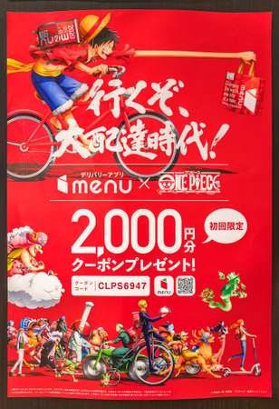 tokyo, japan - july 18 2021: Closeup on a red poster of the Japanese Menu delivery application in collaboration with the superheroes characters of manga One Piece delivering food on a bicycle or bike.