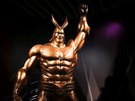tokyo, japan - june 03 2021: Closeup on the bust of the golden statue depicting the superhero All Might raising his fist in the air at the exit of the My Hero Academia exhibition in Roppongi Hills.
