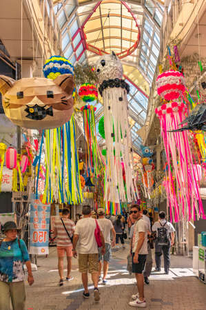 tokyo, japan - august 05 2019: Covered arcade of the Asagaya Pearl Center shopping street helding the traditionnal annual Asagaya Tanabata festival famous for its hung handmade paper-mâché sculptures. Editöryel