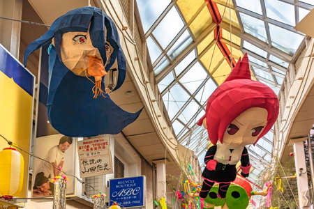 tokyo, japan - august 05 2019: Paper-mache sculptures of Japanese anime characters from Zombie Land Saga and Kemurikusa hung in the Asagaya Pearl Center shopping street during Tanabata festival.
