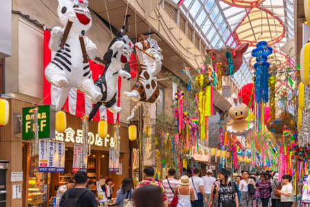 tokyo, japan - august 5 2019: Mashed paper sculptures of japanese folklore characters depicting chindonya music cats in the Asagaya Pearl Center shopping street indoor mall during Tanabata festival.