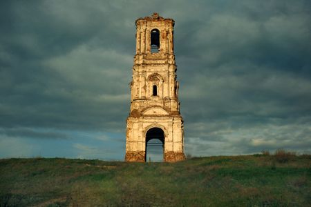 nineteenth: Russa. The Kachalino. The ruins of old belt-tower of the nineteenth centure in dark blue sky.