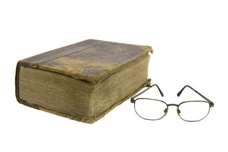 hallowed: Glasses near very old bible on the white background