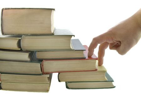 Stack of books and fingers step isolated on the white background photo