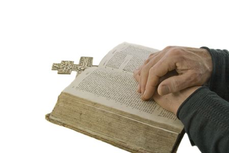 Male hands closed in prayer on an open bible isolated over white Stock Photo - 4443287