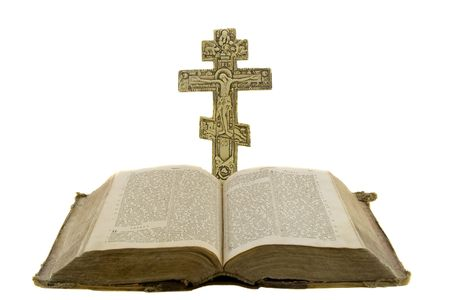 hallowed: Very old vintage open bible and big church cross near to it isolated over white background