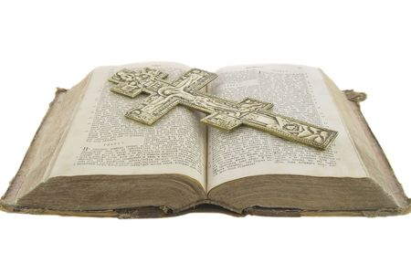 Very old vintage open bible and big church cross on it isolated over white background Stock Photo
