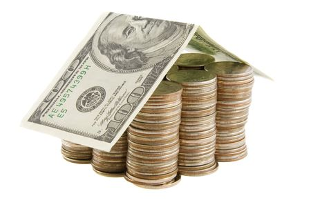 Money house from coins and dollars isolated on white background