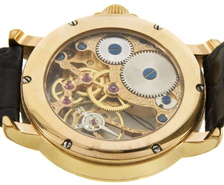 Closeup of rich gold swiss made chronograph watch in white background. Back size