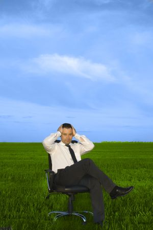 depress: Depress young businessman sitting in the chair Stock Photo