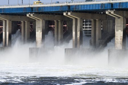 Reset of water on hidroelectric power station on river photo