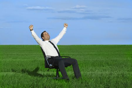 businessman take energy from nature in the meadow with dark blue sky