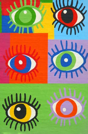 Colorful graffiti spray painted funny eyes on the decorated  brick wall - makes a great background or backdrop