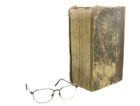 eligion: Glasses near very old bible on the white background