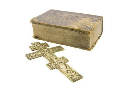 hallowed: Very old vintage bible and big church cross near to it isolated over white background