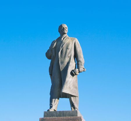 dictator: Statue of Lenin in Volgograd over big blue sky Stock Photo