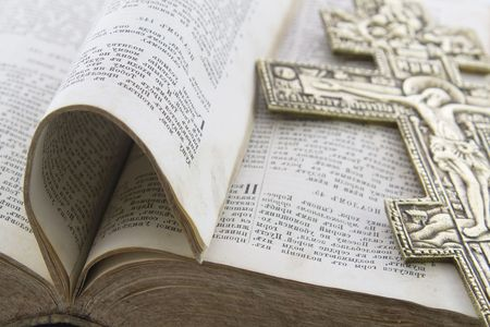 gold cross: Bible with big gold cross on it Stock Photo