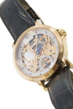 cronografo: Rico en oro en Suiza, el cron�grafo en el fondo blanco Foto de archivo