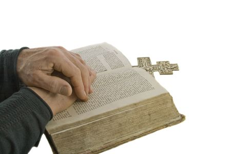 Male hands closed in prayer on an open bible isolated over white Stock Photo - 5051998